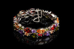 Bracelet with colorful stones  on black, close-up Royalty Free Stock Photo
