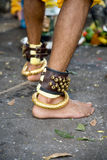 Bracelet of devotion. Thaipusam devotee wearing a bracelet of bells and gold Stock Photos