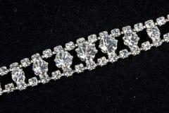 Bracelet with diamonds. On black Stock Photography