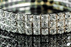 Bracelet with diamonds close-up on a mirror background.  Royalty Free Stock Photo