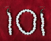 Bracelet and earrings of pearls. Bijouterie Stock Image