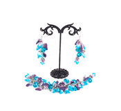 Bracelet and earrings on a stand. Stock Photography