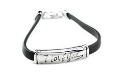 Bracelet en caoutchouc noir avec l'élément en métal Images libres de droits