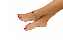 Bracelet on a female foot Royalty Free Stock Photo