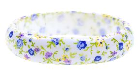 Bracelet with flower decoration isolated on white Stock Photos