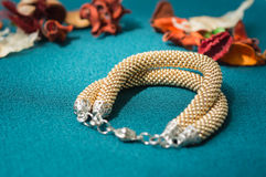 Bracelet of gold color from beads Royalty Free Stock Photo