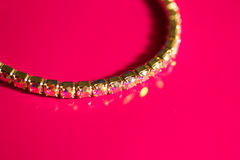 Bracelet. Gold plated bracelet used as a fashion accessory Stock Image