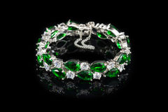 Bracelet with green stones isolated on black, close-up Royalty Free Stock Images