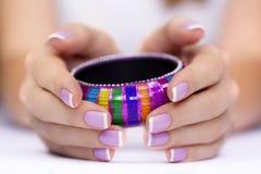 Bracelet in hand royalty free stock image