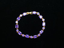 Bracelet hand plastic stones metal jewelery Stock Images