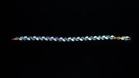 Bracelet hand plastic stones metal jewelery Royalty Free Stock Photo