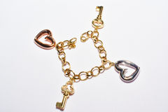 Bracelet with heart and key design. Bracelet with heart and key design isolated in white background Stock Image