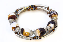 Bracelet isolated. Picture of a bracelet with colored stones and different sized beads stock photography