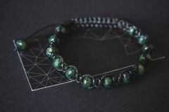 Bracelet with jade on a black background stock photos