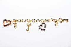 Bracelet with key and heart design. Royalty Free Stock Image