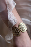 Bracelet and lace. Wedding attire, bracelet and lace veil on arm Royalty Free Stock Photos