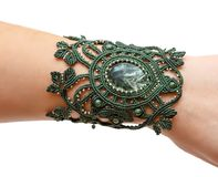 Bracelet from macrame with a stone. On a woman`s hand Royalty Free Stock Images