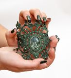 Bracelet from macrame with a stone. On a woman`s hand Stock Photo