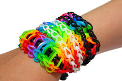 Bracelet made of colorful rainbow loom rubber bands. Stock Photos
