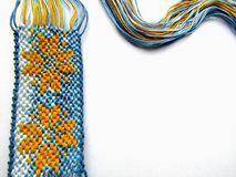 Bracelet made of threads with a flower and threads wave stock photography