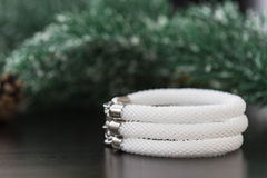Bracelet made of white beads Stock Photo