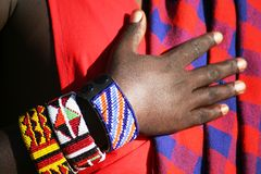 Bracelet on Masai Warrior. African jewellery (bracelet) on the wrist of a warrior man from a Masai tribe in the Masai Mara reserve in Kenya royalty free stock image