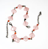 Bracelet from metal and jewels. Of red and pink colour Stock Image