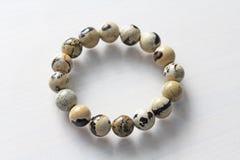 Bracelet from a natural landscape jasper. Bracelet made of natural stones on a white background. Jewelry made of natural stones. stock image