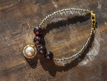 Bracelet with pearl pendant Stock Images