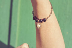 Bracelet with pearl pendant Stock Photography