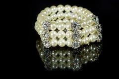 Bracelet of pearls on a black background Stock Image