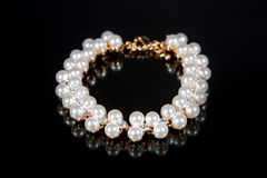 Bracelet of pearls on a black background Royalty Free Stock Images