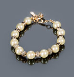 Bracelet of pearls on a gray background Royalty Free Stock Photo