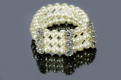 Bracelet of pearls on a gray background Stock Photo