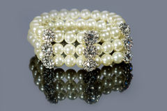Bracelet of pearls on a gray background Royalty Free Stock Photos