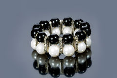 Bracelet of pearls on a gray background Royalty Free Stock Images
