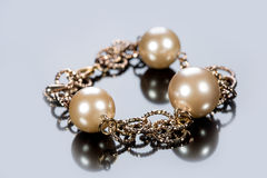 Bracelet of pearls on a gray background Stock Images