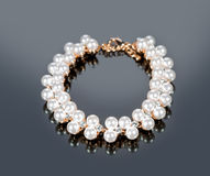 Bracelet of pearls on a gray background Stock Photography