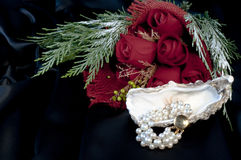 Bracelet of pearls and red roses Stock Photos