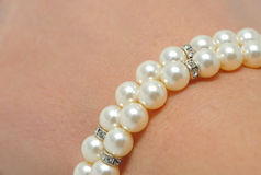 Bracelet of pearls on a woman's hand Royalty Free Stock Images