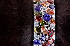 Bracelet with precious stones in a fur Royalty Free Stock Images