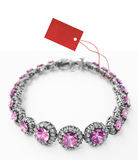 Bracelet with price tag Royalty Free Stock Image