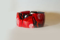 Bracelet red hand on a white background. Ethnic Stock Images