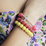Bracelet. Red yellow bracelet beads with a cross Stock Images