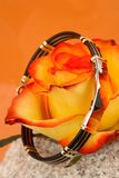 Bracelet and rose Stock Photography