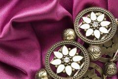 Bracelet on satin Stock Photography