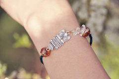 Bracelet with silver owl Stock Images