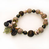 Bracelet stone and glass beads. With pendants Royalty Free Stock Photography
