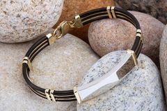 Bracelet on stones Royalty Free Stock Images