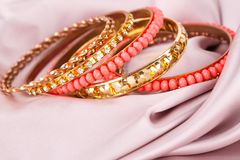 Bracelet. Stylish bracelets on fabric background Stock Photo